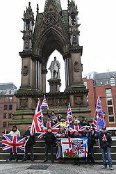 © Licensed to London News Pictures . 19/01/2013 . Manchester , UK . People attending the demonstration display a National Front flag underneath the Albert Memorial in Manchester , UK today . Loyalist protesters demonstrate outside Manchester Town Hall in the city's Albert Square , today (19th January 2013) . Photo credit : Joel Goodman/LNP