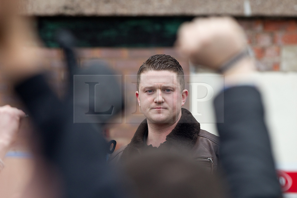 © Licensed to London News Pictures . FILE PICTURE DATED 25/02/2012 . The EDL leader , STEPHEN YAXLEY-LENNON ( aka TOMMY ROBINSON ) ( pictured at a demonstration in Hyde ) has announced he intends to turn the EDL in to a political party after quitting as a Vice Chairman of the British Freedom Party . Photo credit : Joel Goodman/LNP