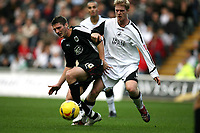 Photo: Rich Eaton.<br /> <br /> Swansea City v Bristol City. Coca Cola League 1. 26/11/2006. Phil Jevons #10 of Bristol and Alan Tate of Swansea