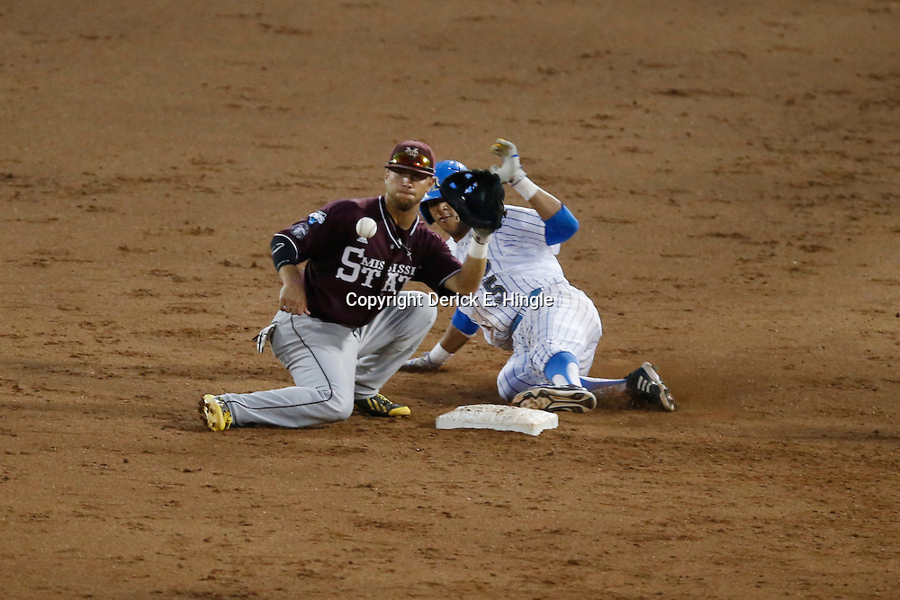 Jun 25, 2013; Omaha, NE, USA; UCLA Bruins designated hitter Kevin Williams (5) slides safely into second base against Mississippi State Bulldogs second baseman Brett Pirtle (front) for a double during the fifth inning in game 2 of the College World Series finals at TD Ameritrade Park. Mandatory Credit: Derick E. Hingle-USA TODAY Sports