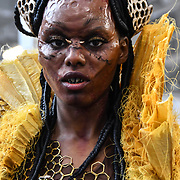Model Dunia Abdi the Queen Bee by Artist Ida Astero Welle  - Mothermorphosis demo at IMATS London on 18 May 2019,  London, UK.