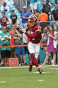 Sunday, October 13, 2019; Miami Gardens, FL USA;  Washington Redskins wide receiver Terry McLaurin (17) catches a pas during pregame warmups prior to an NFL game against the Dolphins at Hard Rock Stadium. The Redskins beat the Dolphins 17-16. (Kim Hukari/Image of Sport)