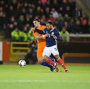 9th November 2017, Pittodrie Stadium, Aberdeen, Scotland; International Football Friendly, Scotland versus Netherlands; Scotland's Matt Phillips battles for the ball with    Holland's Karim Rekik