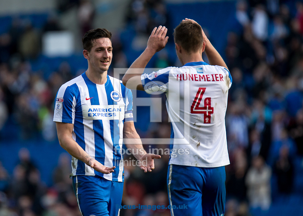 Lewis Dunk of Brighton &amp; Hove Albion and Uwe Hunemeier during the Sky Bet Championship match at the American Express Community Stadium, Brighton and Hove<br /> Picture by Liam McAvoy/Focus Images Ltd 07413 543156<br /> 01/04/2017