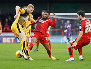 Ross Jenkins of Crawley Town tries to get  tackle in during the Sky Bet League 2 match between Crawley Town and Cambridge United at the Checkatrade.com Stadium, Crawley, England on 9 January 2016. Photo by Andy Walter.