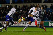 Picture by David Horn/Focus Images Ltd +44 7545 970036<br /> 28/01/2014<br /> Ryan Fredericks of Millwall attempts to block a shot from Atdhe Nuhiu (centre) of Sheffield Wednesday during the Sky Bet Championship match at The Den, London.