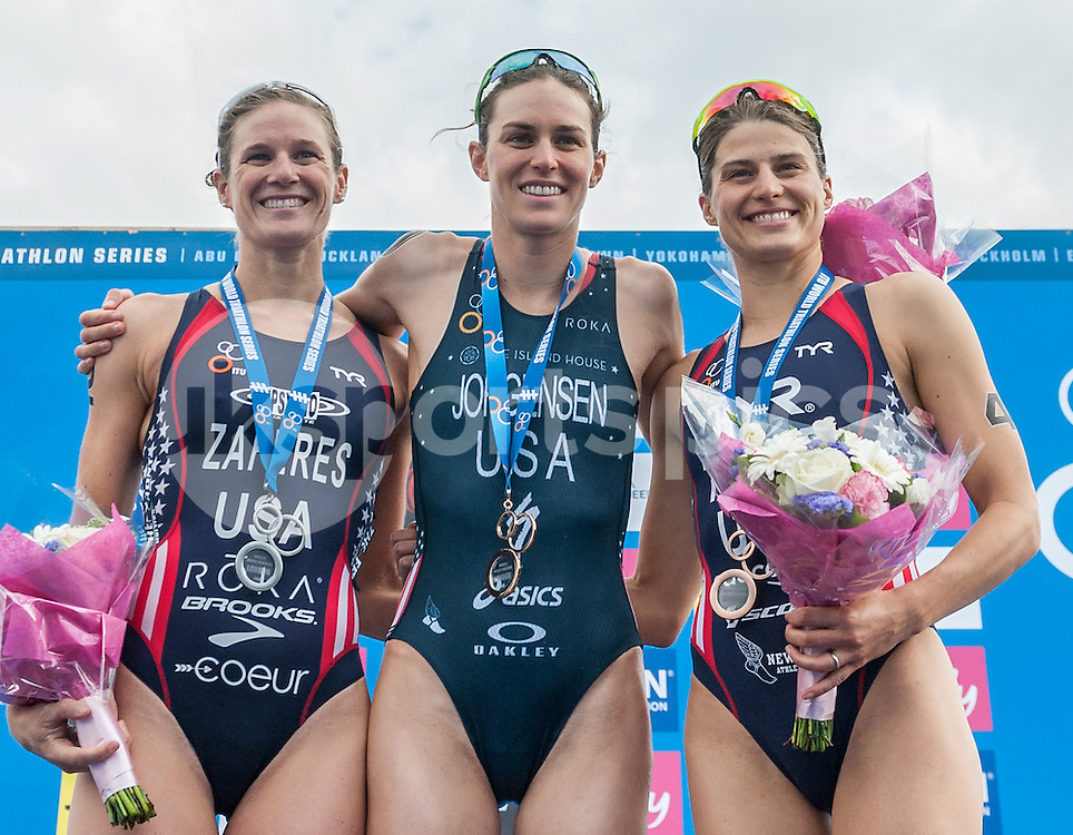 Katie Zaferes (USA) (2), Gwen Jorgensen (USA) (1) and Sarah TRUE (USA) (4) share the podium during The ITU Vitality World Triathlon at London, England on 31 May 2015. Photo by Vince  Mignott.