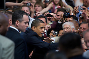US President Barack Obama greets supporters following a town hall meeting in Rio Rancho, New Mexico, USA, on 14 May 2009. Obama called on Congress to pass tougher regulation over the credit card industry.