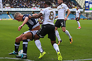 Vurnon Anita of Leeds United (right) attempts to tackle Steve Morison of Millwall during the EFL Sky Bet Championship match between Millwall and Leeds United at The Den, London, England on 16 September 2017. Photo by Toyin Oshodi.