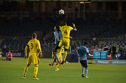 November 5, 2017 - Bronx, New York, U.S - Columbus Crew defender JONATHAN MENSAH (4) heads the ball away from New York City FC forward DAVID VILLA (7) while Columbus Crew defender JOSH WILLIAMS (3) and New York City FC midfielder MAXIMILIANO MORALEZ (10) look on during leg 2 of the Eastern Conference Semifinal at Yankee Stadium, Bronx, NY.  NYCFC defeats Columbus Crew 2-0.  Columbus wins 4-3 on aggregate. (Credit Image: © Mark Smith via ZUMA Wire)