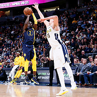 03 April 2018: Indiana Pacers guard Darren Collison (2) takes a jump shot over Denver Nuggets center Nikola Jokic (15) during the Denver Nuggets 107-104 victory over the Indiana Pacers, at the Pepsi Center, Denver, Colorado, USA.