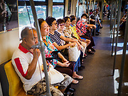 06 DECEMBER 2018 - SAMUT PRAKAN, THAILAND:  Passengers ride the new east extension of the BTS Skytrain on the opening day of the extension. The 12.6 kilometer (7.8 miles) east extension of the Sukhumvit Line of the Bangkok BTS Skytrain goes into Samut Prakan, a town east of Bangkok.  The system is now 51 kilometers long (32 miles), including the 12.6 kilometer extension that opened December 06. About 900,000 people per day use the BTS.     PHOTO BY JACK KURTZ