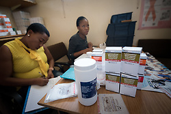 2 March 2017, Ma Mafefooane Valley, Lesotho: Nurses prescribe HIV medication at Saint Joseph's Hospital. Saint Joseph's Hospital is a district hospital in the Ma Mafefooane Valley in Lesotho. The hospital was established in 1937 and is run as a Roman Catholic non-profit institution by the Christian Health Association of Lesotho. As a district hospital, it offers comprehensive healthcare including male, female, paediatric, Tuberculosis and maternity care. It is closely linked with the neighbouring Roma College of Nursing, which runs on similar premises as part of the same institution. Drug supplies are secured to the hospital by means of a Memorandum of Understanding with the government.