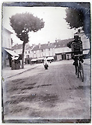 street scene with cyclist and pedestrians 1900s France