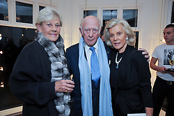 Left to right, PRINCE & PRINCESS RUPERT LOWENSTEIN and MARINA CICOGNA at a private view of photographs by Marina Cicogna from her book Scritti e Scatti held at the Little Black Gallery, 3A Park Walk London SW10 on 16th October 2009.