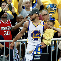 12 June 2017: Golden State Warriors forward Andre Iguodala (9) celebrates with his daughter during the Golden State Warriors 129-120 victory over the Cleveland Cavaliers, in game 5 of the 2017 NBA Finals, at the Oracle Arena, Oakland, California, USA.