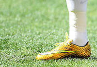 The personalised gold boots of Neymar of Brazil with Davi Lucca and a music sign on them