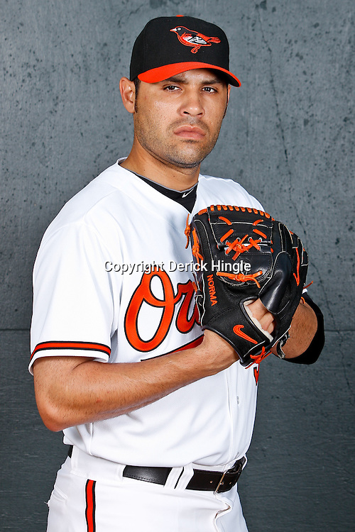 February 26, 2011; Sarasota, FL, USA; Baltimore Orioles relief pitcher Mike Gonzalez (51) poses during photo day at Ed Smith Stadium.  Mandatory Credit: Derick E. Hingle