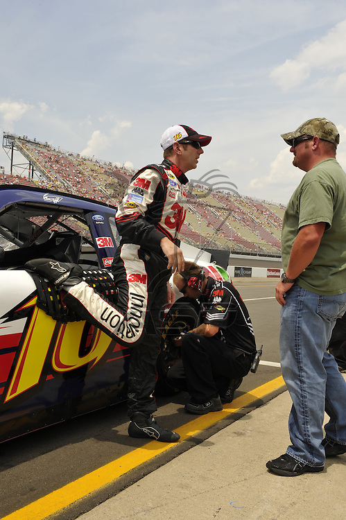 Brooklyn, MI - JUN 16, 2012: Greg Biffle (16) exits his race car after qualifying for the Quicken Loans 400 race at the Michigan International Speedway in Brooklyn, MI.