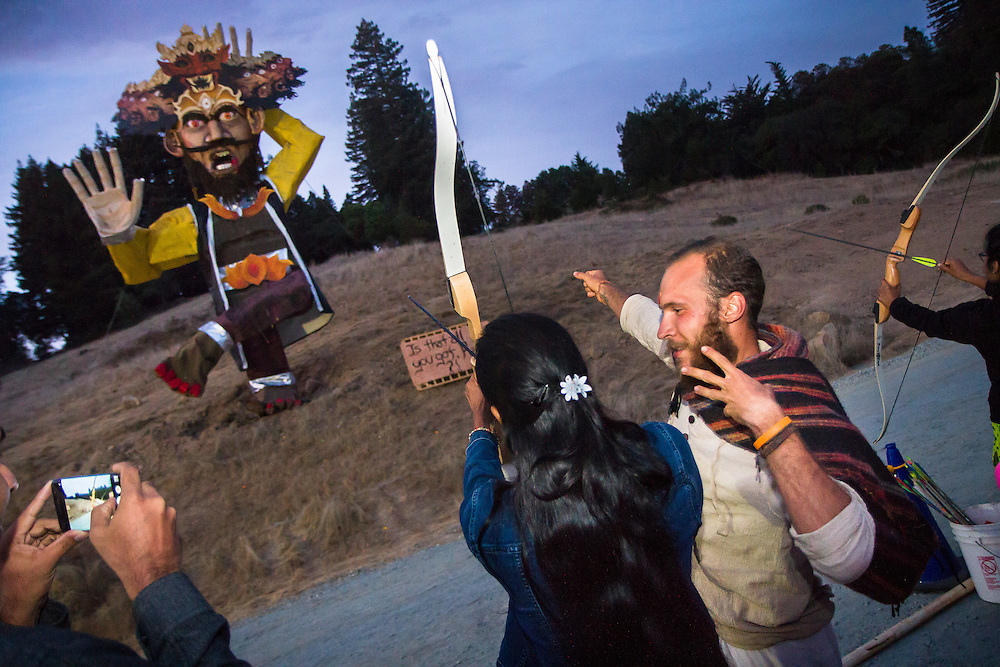 Watsonville, California: Hindu devotees shoot arrows into an effigy of Ravana, the villain of the Ramayana epic, whose destruction every year is part of the festival of Dussehra. The death of Ravana marks the triumph of good over evil.