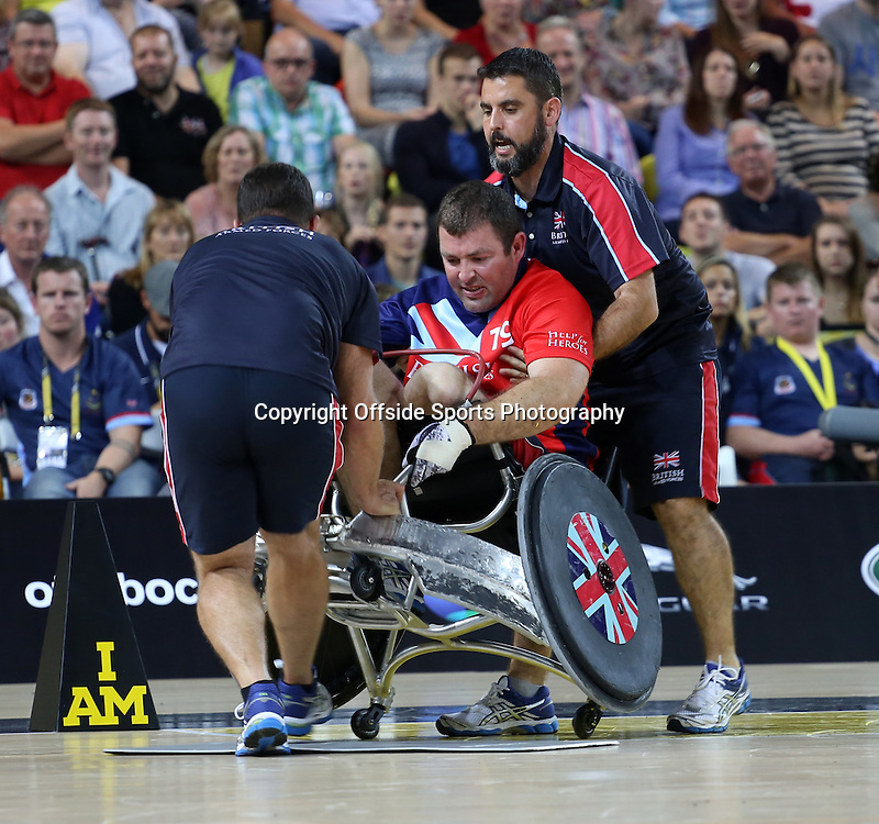 12 September 2014 - Invictus Games Day 2 - A Team GB athlete is helped up after being knocked over.<br /> <br /> Photo: Ryan Smyth/Offside