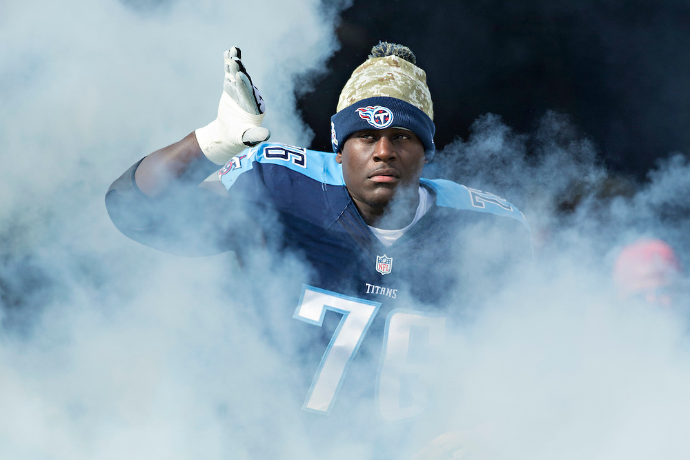 NASHVILLE, TN - NOVEMBER 15:  Byron Bell #76 of the Tennessee Titans runs onto the field before a game against the Carolina Panthers at Nissan Stadium on November 15, 2015 in Nashville, Tennessee.  (Photo by Wesley Hitt/Getty Images) *** Local Caption *** Byron Bell