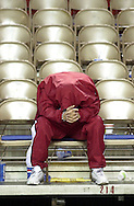 Hutchinson's Aaron Lashley sits dejected with his head down after a 68-66 loss to Seward County Tuesday in the Region 6 semi final game at the Bicentennial Center in Salina. (Travis Morisse 3-12-02)