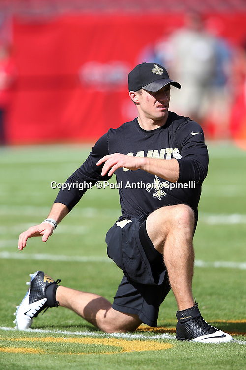 New Orleans Saints quarterback Drew Brees (9) stretches before the 2015 week 14 regular season NFL football game against the Tampa Bay Buccaneers on Sunday, Dec. 13, 2015 in Tampa, Fla. The Saints won the game 24-17. (©Paul Anthony Spinelli)