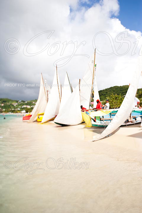 Traditional workboats racing off Grand Anse Beach in Grenada.