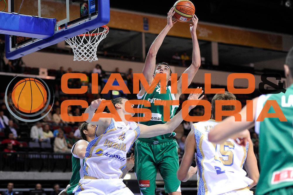 DESCRIZIONE : Klaipeda Lithuania Lituania Eurobasket Men 2011 Preliminary Round Ucraina Slovenia Ukraine Slovenia<br /> GIOCATORE : Mirza Begic<br /> SQUADRA : Slovenia<br /> EVENTO : Eurobasket Men 2011<br /> GARA : Ucraina Slovenia Ukraine Slovenia<br /> DATA : 01/09/2011<br /> CATEGORIA : tiro penetrazione<br /> SPORT : Pallacanestro <br /> AUTORE : Agenzia Ciamillo-Castoria/C.De Massis<br /> Galleria : Eurobasket Men 2011<br /> Fotonotizia : Klaipeda Lithuania Lituania Eurobasket Men 2011 Preliminary Round Ucraina Slovenia Ukraine Slovenia<br /> Predefinita :