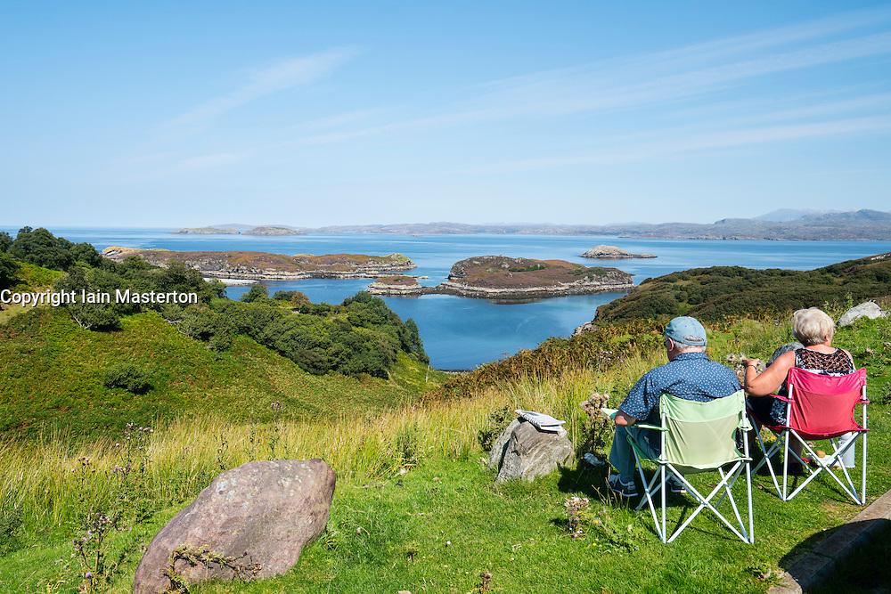 Tourists enjoy view from Drumbeg Viewpoint towards Eddrachillis Bay,Sutherland, Scotland, United Kingdom