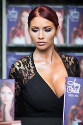 © Licensed to London News Pictures . 10/10/2015 . Manchester , UK . AMY CHILDS signs copies of her book , 100% Me , at Waterstones in the Trafford Centre in Manchester . Photo credit : Joel Goodman/LNP