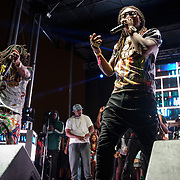 "WASHINGTON, DC - August 23rd, 2014 - Quavo and Takeoff of Atlanta rap trio Migos perform at the 3rd annual Trillectro Music Festival at RFK Stadium in Washington, D.C. The group is known for their singles ""Versace"" and ""Hannah Montana."" (Photo by Kyle Gustafson / For The Washington Post)"