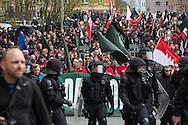 Plauen, Germany -  01.05.2016 <br /> <br /> Hundreds of neo-Nazis participated in a march of the radical right-wing party &acute;Der III. Weg&acute; on the first of May in the Saxon small town Plauen. Because of disputes over the protest route the organizers end their march after a part of the route. Immediately afterwards neo-Nazis try to break through police lines and attack police forces. The police reacts with water cannons, tear gas, pepper spray and batons. After the situation calmed down the police a accepted a following demonstration application back to the starting point.<br /> <br /> Hunderte Neonazi beteiligten sich an einem Aufmarsch der rechtsradikalen Partei III.Weg am 01. Mai im saechsischen Plauen. Wegen Streitigkeiten ueber die Aufzugsroute beendeten die Veranstalter die Demonstration nach einem Teil der Wegstrecke. Unmittelbar darauf versuchten die Rechtsradikalen Polizeikraefte an versuchten Polizeiketten zu durchbrechen. Die Polizei setzte daraufhin Wasserwerfer, Traenengas, Pfefferspray und Schlagstoecke ein. Nachdem sich die Situation beruhigt hatte lie&szlig; die Polizei einer erneute Demonstrationsanmeldung zu - die zurueck zum Startpunkt fuehrte.
