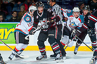 KELOWNA, CANADA -FEBRUARY 5: Adam Musil C #25 of the Red Deer Rebels is checked by Nick Merkley #10 of the Kelowna Rockets on February 5, 2014 at Prospera Place in Kelowna, British Columbia, Canada.   (Photo by Marissa Baecker/Getty Images)  *** Local Caption *** Adam Musil; Nick Merkley;