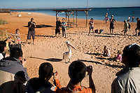 Tourists facinated by the pelicans at Monkey Mia  beach. Monkey Mia and Shark Bay is 850 kms north of Western Australian capital Perth. Situated mid way up the Western Australian coast the area famous for it's wild dolphins and is classified as a World Heritage Region.