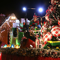 Adam Robison | BUY AT PHOTOS.DJOURNAL.COM<br /> The Scruggs, Farm, Lawn and Garden float, moves through the Tupelo Christmas Parade Friday night.