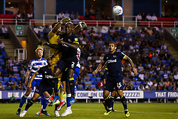 Vito Mannone of Reading punches the ball clear of Andre Wisdom of Derby County - Mandatory by-line: Robbie Stephenson/JMP - 03/08/2018 - FOOTBALL - Madejski Stadium - Reading, England - Reading v Derby County - Sky Bet Championship