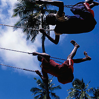 Children playing on swings in Mombassa, Kenya. September 2003.
