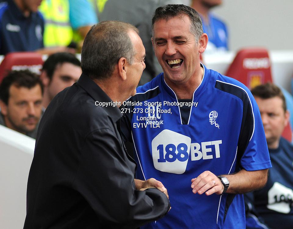 21/08/2010 - Premiership Football - West Ham United vs Bolton Wanderers - Avram Grant and Owen Coyle share a joke. - Photo: Charlie Crowhurst / Offside.