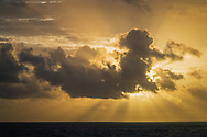 """Rise of the Mayan Sun God,"" Crespuscular Rays (Sunbeams) behind stratocumulus cloud at sunrise over the Caribbean Sea from Cancun, Quintana Roo, Yucatan Peninsula, Mexico"