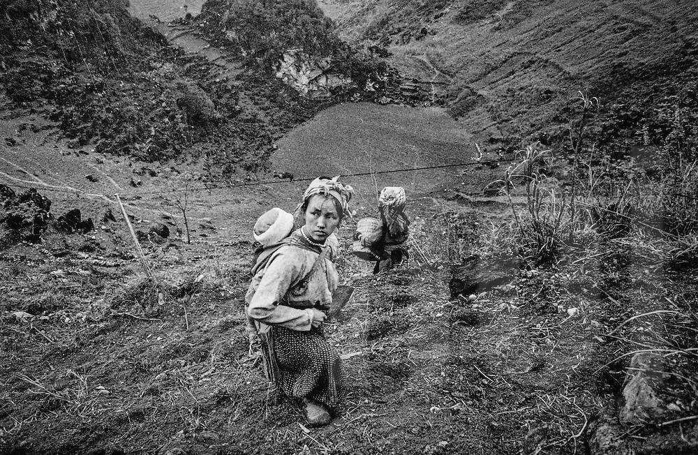 Portrait of a hilltribe woman standing on a steep slope in Ha Giang Province, Vietnam, Southeast Asia