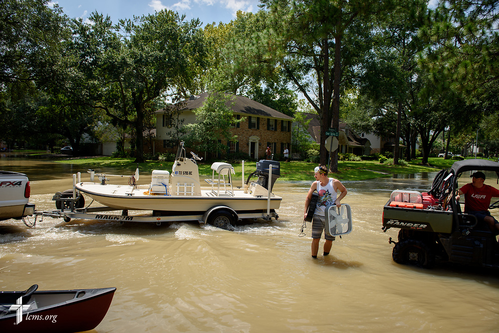 Residents in Houston use boats to access their flooded homes on Friday, Sept. 1, 2017. LCMS Communications/Erik M. Lunsford