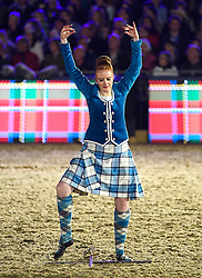 © Licensed to London News Pictures. 15/05/2016. Windsor, UK.  A Scottish dancer. An evening event held at the Royal Windsor Horse show to celebrate the 90th birthday of HRH Queen Elizabeth II. Acts from arounds the world have been invited to perform at the evening event, set in the grounds of Windsor Castle. Photo credit: Ben Cawthra/LNP