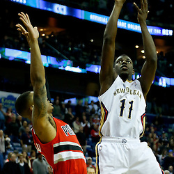 Dec 30, 2013; New Orleans, LA, USA; New Orleans Pelicans point guard Jrue Holiday (11) shoots over Portland Trail Blazers point guard Damian Lillard (0) during the first quarter of a game at the New Orleans Arena. Mandatory Credit: Derick E. Hingle-USA TODAY Sports
