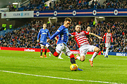 James Tavernier of Rangers looks to cross the ball deep in the Hamilton Box while under pressure during the Ladbrokes Scottish Premiership match between Rangers and Hamilton Academical FC at Ibrox, Glasgow, Scotland on 16 December 2018.