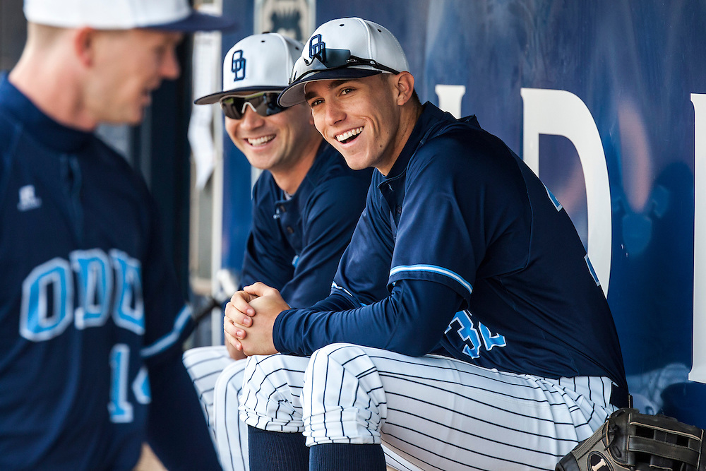 May 3, 2013; Norfolk, VA; ODU Monarchs right fielder Ben Verlander (32) smiles in the dugout with teammate Drew Coker (left) before the game against the George Mason Patriots at the Bud Metheny Baseball Complex . Mandatory Credit: Peter Casey-USA TODAY Sports