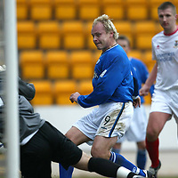 St Johnstone v Inverness Caley Thistle...13.03.04<br />Mixu Paatelainen puts the ball past Mark Brown to score St Johnstone's second goal.<br />Picture by Graeme Hart.<br />Copyright Perthshire Picture Agency<br />Tel: 01738 623350  Mobile: 07990 594431