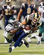 ST. LOUIS, MO - SEPTEMBER 11:   Danny Amendola #16 of the St. Louis Rams is tackled after making a catch by Dominique Rodgers-Cromartie #23 of the Philadelphia Eagles at the Edward Jones Dome on September 11, 2011 in St. Louis, Missouri.  The Eagles defeated the Rams 31 to 13.  (Photo by Wesley Hitt/Getty Images) *** Local Caption *** A.J. Feeley; Dominique Rodgers-Cromartie