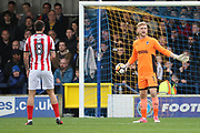 AFC Wimbledon goalkeeper George Long (1) clearing the ball during the The FA Cup match between AFC Wimbledon and Lincoln City at the Cherry Red Records Stadium, Kingston, England on 4 November 2017. Photo by Matthew Redman.